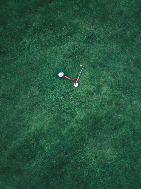 Magdalena Russocka aerial view of abandoned child scooter in garden