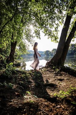 Stephen Carroll WOMAN IN WHITE DRESS NEAR LAKE Women