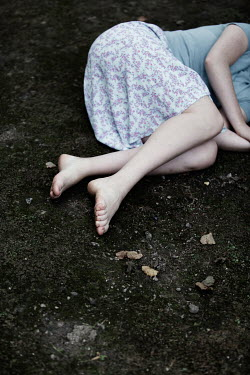 Magdalena Russocka legs of woman lying down on ground