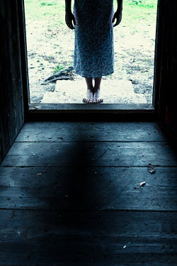 Magdalena Russocka legs of woman entering old wooden house