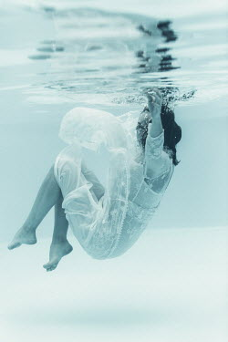 Magdalena Russocka woman in white dress underwater