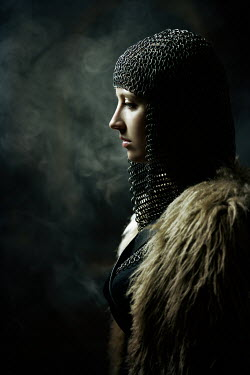 Magdalena Russocka close up of historical woman in chainmail and fur cape in room with smoke