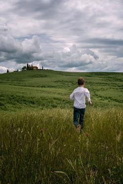 Galya Ivanova BOY RUNNING IN COUNTRYSIDE WITH FARMHOUSE Children