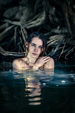 Stephen Carroll GIRL IN RIVER AT NIGHT WITH TREE ROOTS Women