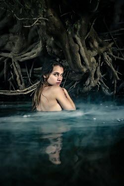 Stephen Carroll NAKED GIRL IN RIVER WITH TREE ROOTS Women