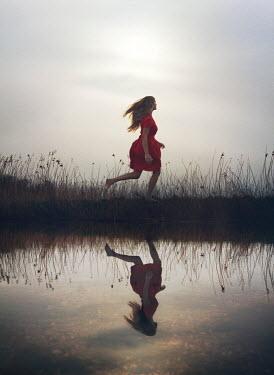 Mark Owen RUNNING GIRL REFLECTED IN RIVER Women