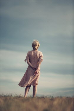 Magdalena Russocka young blonde woman standing in field