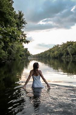Stephen Carroll GIRL WALKING IN RIVER IN SUMMER Women