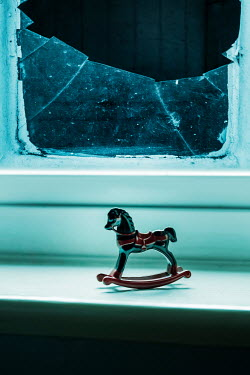 Stephen Mulcahey TOY ROCKING HORSE BY BROKEN WINDOW Miscellaneous Objects