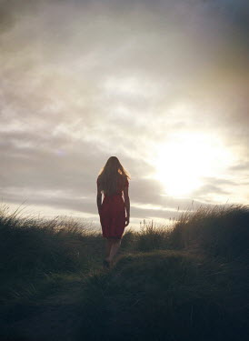 Mark Owen BLONDE GIRL WALKING IN DUNES AT SUNSET Women