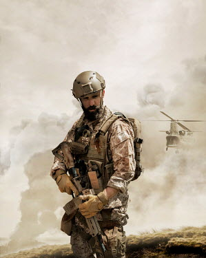 CollaborationJS A modern special forces soldier standing in  a warzone