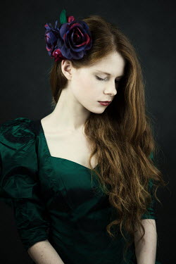 Magdalena Russocka close up of sad woman with flowers in hair inside