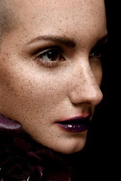 Elena Bovo Young woman with purple lipstick and freckles
