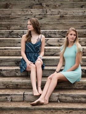 Elisabeth Ansley Teenage girls sitting on wooden steps Women