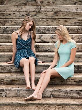Elisabeth Ansley Teenage girls sitting on wooden steps