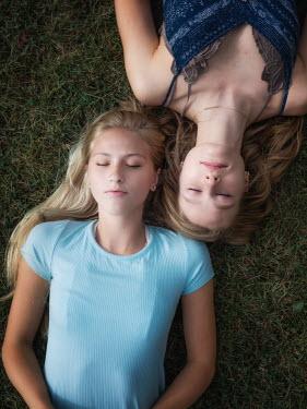 Elisabeth Ansley Friends lying in grass Women