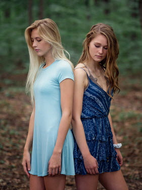 Elisabeth Ansley Teenage girls standing back to back Women