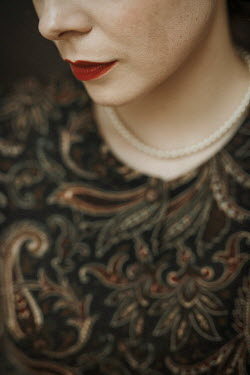 Shelley Richmond Woman with red lipstick and pearl necklace Women