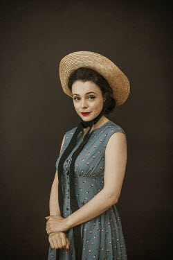 Shelley Richmond Young woman in 1940s dress and straw hat Women