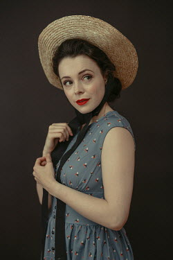 Shelley Richmond Young woman in 1940s dress and straw hat