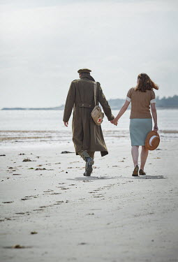 CollaborationJS WARTIME COUPLE HOLDING HANDS ON BEACH Couples