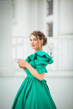 Joanna Czogala HISTORICAL WOMAN DRINKING TEA OUTSIDE HOUSE Women
