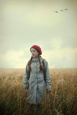 Magdalena Russocka retro teenage girl with school bag standing in field