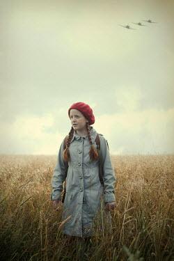Magdalena Russocka retro teenage girl with school bag standing in field