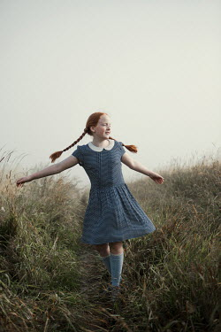 Magdalena Russocka happy young girl running in misty field