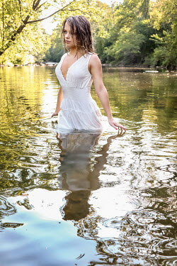 Stephen Carroll WOMAN WADING IN RIVER IN SUMMER Women