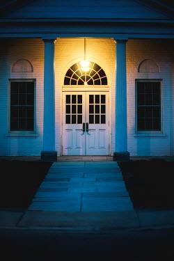 Evelina Kremsdorf EXTERIOR OF WHITE HOUSE WITH PORCH LIGHT Houses