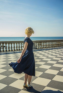 Nikaa BLONDE RETRO WOMAN ON BREEZY SEAFRONT Women
