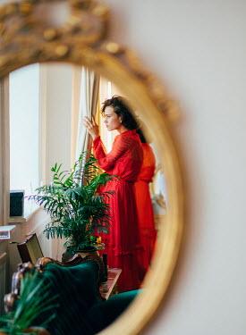 Marta Syrko REFLECTION OF WOMAN IN SITTING ROOM Women