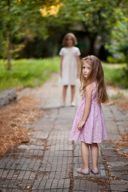 Kerstin Marinov TWO LITTLE GIRLS STANDING IN GARDEN Children