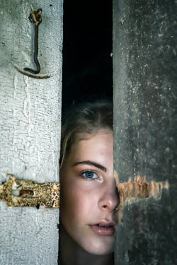 Stephen Carroll Girl looking through ajar door Women