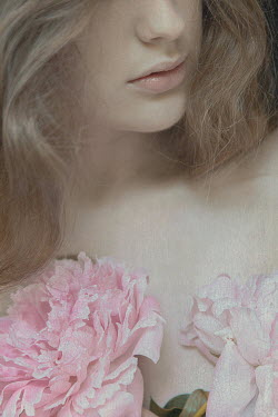 Natasza Fiedotjew CLOSE UP OF WOMAN WITH PINK FLOWERS Women
