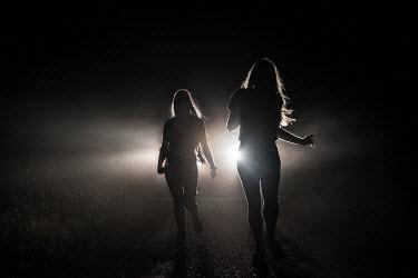 Terry Bidgood two girls running from the light Women
