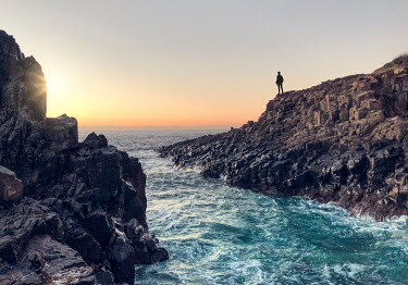 Evelina Kremsdorf SILHOUETTED MAN ON ROCKS WATCHING SEA Men