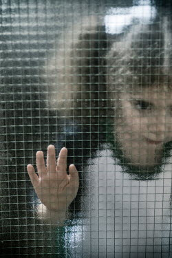 Mohamad Itani Girl staring from behind frosted glass Children