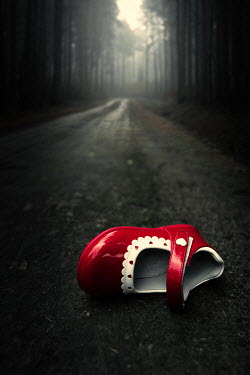 Magdalena Russocka red girl's shoe abandoned in forest