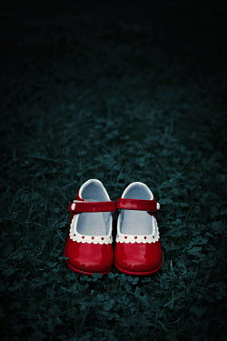 Magdalena Russocka red girl's shoes left on grass
