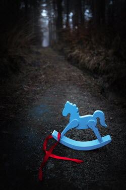 Magdalena Russocka wooden rocking horse abandoned in forest