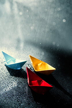 Magdalena Russocka three little paper boats floating in rain