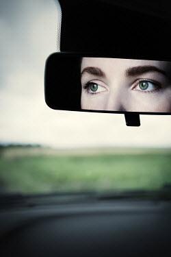 Magdalena Russocka woman reflected in car mirror