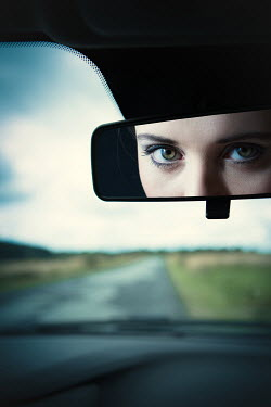 Magdalena Russocka woman reflected in car mirror
