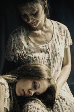 Natasza Fiedotjew Two young women hugging indoors