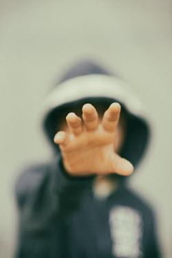Krasimira Petrova Shishkova boy in hoodie reaching out hand
