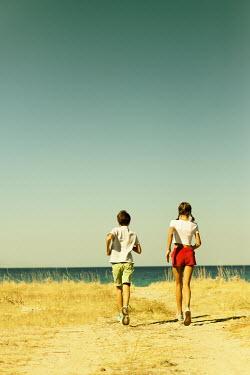 Krasimira Petrova Shishkova YOUNG BOY AND GIRL RUNNING BY SEA Children