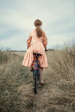 Magdalena Russocka retro woman riding bike min field
