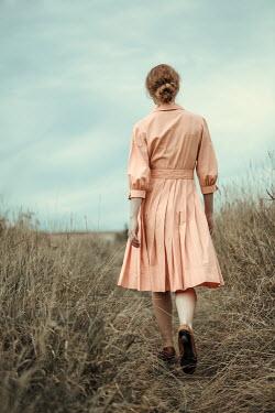 Magdalena Russocka retro woman walking in field